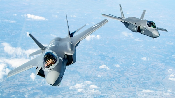 Two F-35 Lightning II's bank after receiving fuel over the Midwest Sept. 19, 2019. The two aircraft were in route to the 158th Fighter Wing out of the Vermont Air National Guard Base, South Burlington, Vt., the fist Air National Guard unit to receive the aircraft. (U.S. Air Force photo/Master Sgt. Ben Mota)