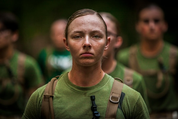 Officer candidate stands at attention during Medal of Honor run at Officer Candidates School aboard Marine Corps Base Quantico, Virginia, August 15, 2019 (U.S. Marine Corps/Phuchung Nguyen)