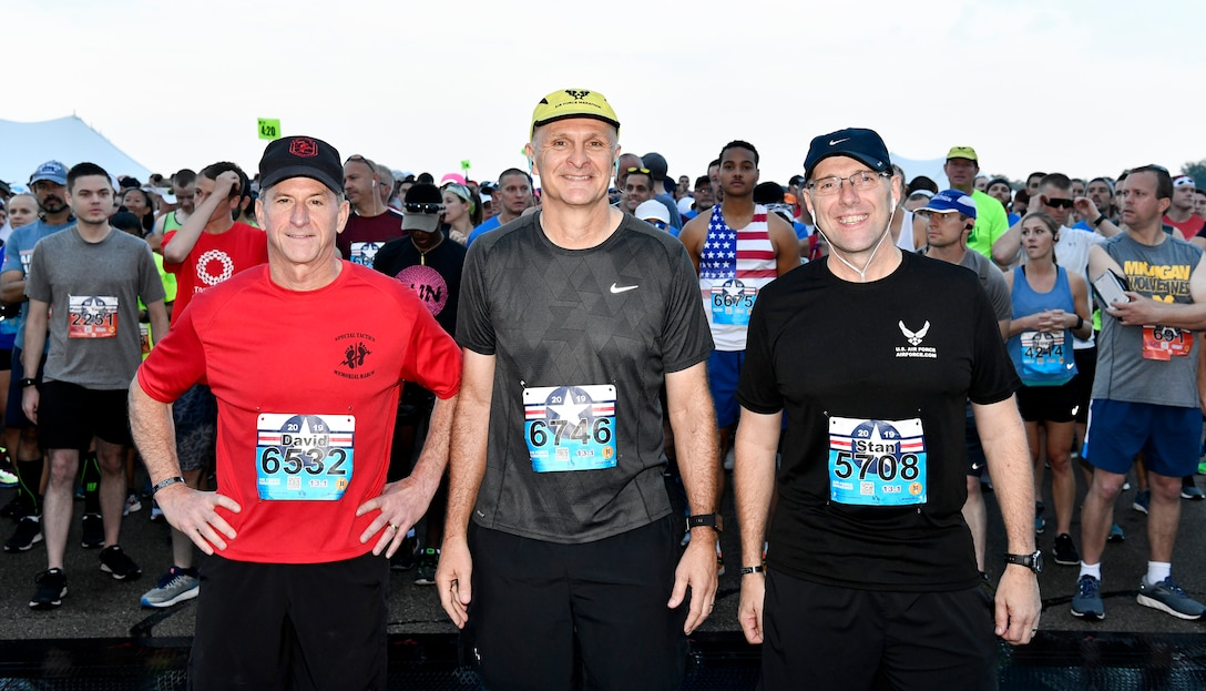 Air Force Chief of Staff Gen. David L. Goldfein and Air Force Materiel Command's commander, Gen. Arnold W. Bunch Jr., congratulate participants in the 23rd Air Force Marathon, hosted by Wright-Patterson Air Force Base, Ohio, Sept. 21, 2019.