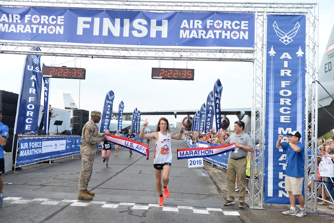 Juris Silenieks, Bath Township, Michigan, crosses the finish line winning the 2019 Air Force Marathon with a time of 2:22:37.  (Air Force photo by Wes Farnsworth)