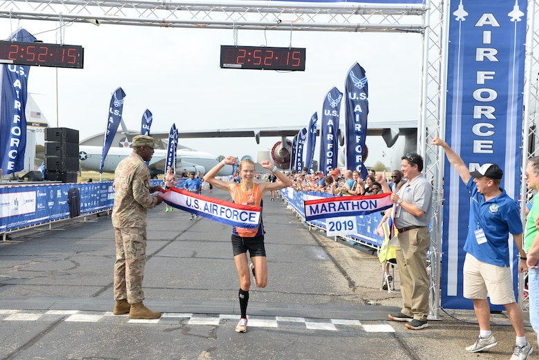 Ann Alyanak of Bellbrook crosses the line at 2:52:15 capturing the Women's title for the 2019 Air Force Marathon.(U.S. Air Force photo/Wesley Farnsworth)