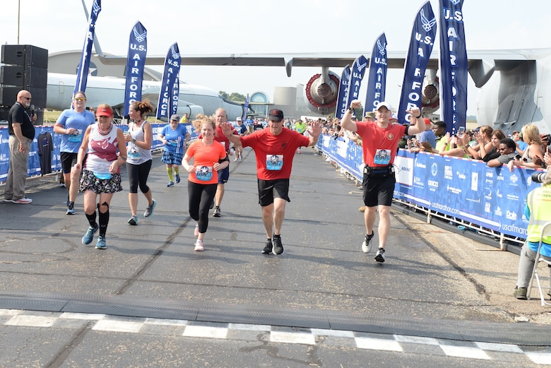 Gen. David L. Goldfein celebrates as he crosses the finish line at the 2019 Air Force Marathon at Wright-Patterson AFB, Ohio.(U.S. Air Force photo/Wesley Farnsworth)
