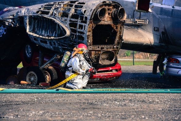 A firefighter crouches during a during a large-scale exercise September 21, 2019, at Harrisburg International Airport in Middletown, Pennsylvania.