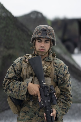 U.S. Marine Lance Cpl. Gabriel Marrero, a fire directional control specialist with Headquarters Battery, 12th Marine Regiment, 3rd Marine Division, stands security during Thunder Field Training Exercise on Camp Hansen, Okinawa, Japan, Sept. 18, 2019. The purpose of the exercise is to rehearse setting up an expeditionary combat operations center and refine procedures for doing so. Marrero is a native of Atlantic City, N.J. (U.S. Marine Corps photo by Pfc. Jamal Norris)