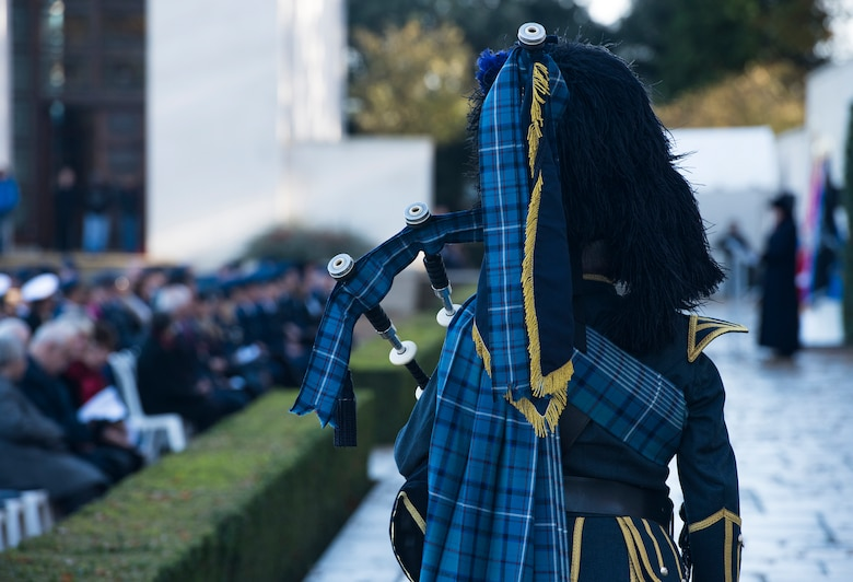 Royal Air Force Warrant Officer Gary Kernagham (Ret'd), performs Taps during a Veterans Day memorial event located at the Cambridge American Cemetery and Memorial, England on November 12, 2018. The ceremony marked 100 years since the first Armistice day on Nov. 11, 1918 when World War I came to an end. (U.S. Air Force photo by TSgt. Brian Kimball)