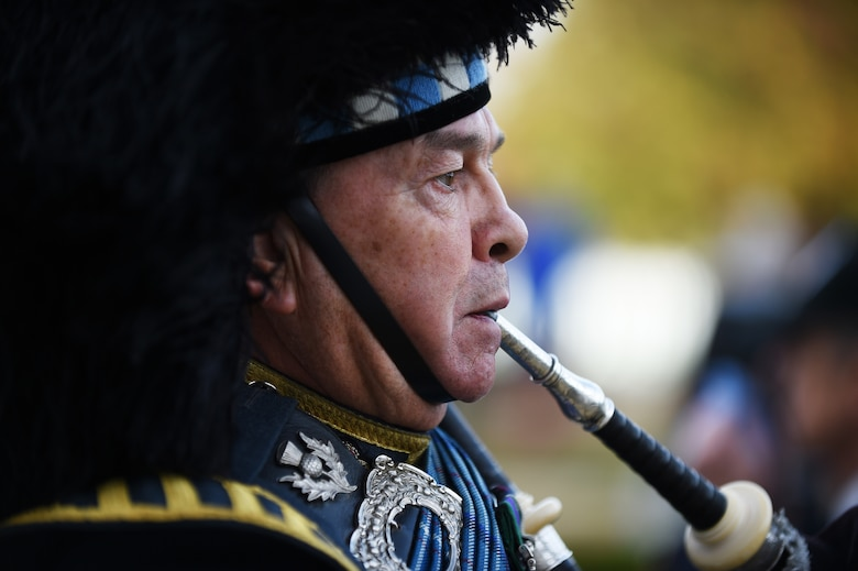 Royal Air Force Warrant Officer, retired, Gary Kernaghan plays a bagpipe during a Veterans Day ceremony at Cambridge American Cemetery, United Kingdom, Nov. 11, 2015. Since 1919, the United States has set aside the 11th day of November to remember the sacrifices of veterans both past and present. (U.S. Air Force photo by Staff Sgt. Jarad A. Denton)