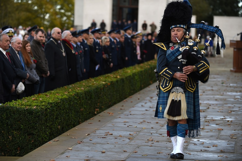 Royal Air Force Warrant Officer, retired, Gary Kernaghan plays the bagpipes during a Veterans Day ceremony at Cambridge American Cemetery, United Kingdom, Nov. 11, 2014. Since 1919, the United States has set aside the 11th day of November to remember the sacrifices of veterans both past and present. (U.S. Air Force photo by Staff Sgt. Jarad A. Denton)