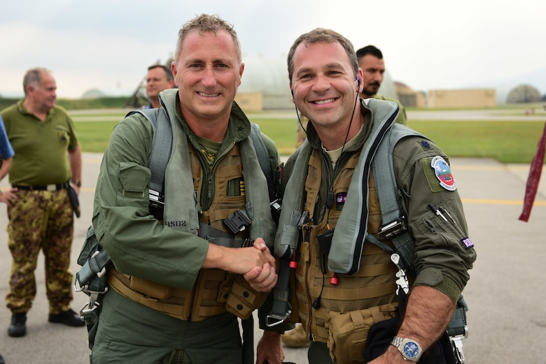 Italian air force Col. Vincenzo Tozzi, Aviano base commander, left, and U.S. Air Force Lt. Col. Daniel Lindsey, commander of the 510th Fighter Squadron, pose for a photo at Aviano Air Base, Italy, Sept. 17, 2019. Col. Tozzi was Lt. Col. Lindsey's instructor pilot while they were at Sheppard Air Force Base, Texas, 16 years ago. (U.S. Air Force photo by Staff Sgt. Kelsey Tucker)