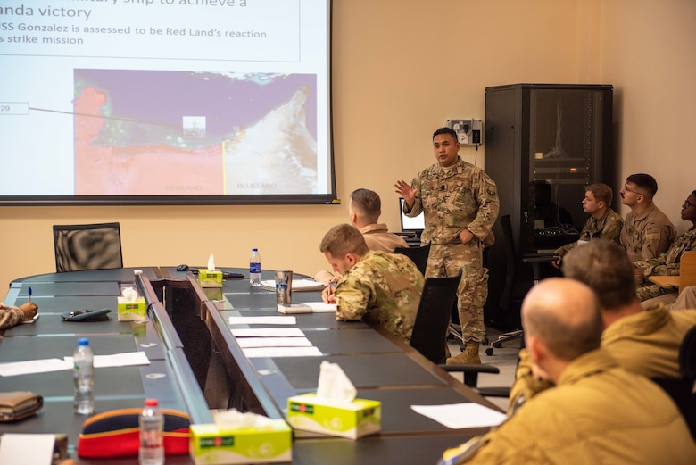 Capt. Patterson Aldueza, U.S. Air Forces Central Command AWC intelligence branch officer, briefs mission planning during a large force exercise Aug. 27, 2019, United Arab Emirates. The exercise brought French, Emirati and American forces together to build partnerships, tactical capabilities and interoperability with allies. (U.S. Air Force photo by Staff Sgt. Chris Thornbury)