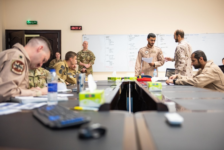The Blue Team breaks into small groups during mission planning for a large force exercise Aug. 27, 2019, United Arab Emirates. The exercise brought French, Emirati and American forces together to build partnerships, tactical capabilities and interoperability with allies. (U.S. Air Force photo by Staff Sgt. Chris Thornbury)