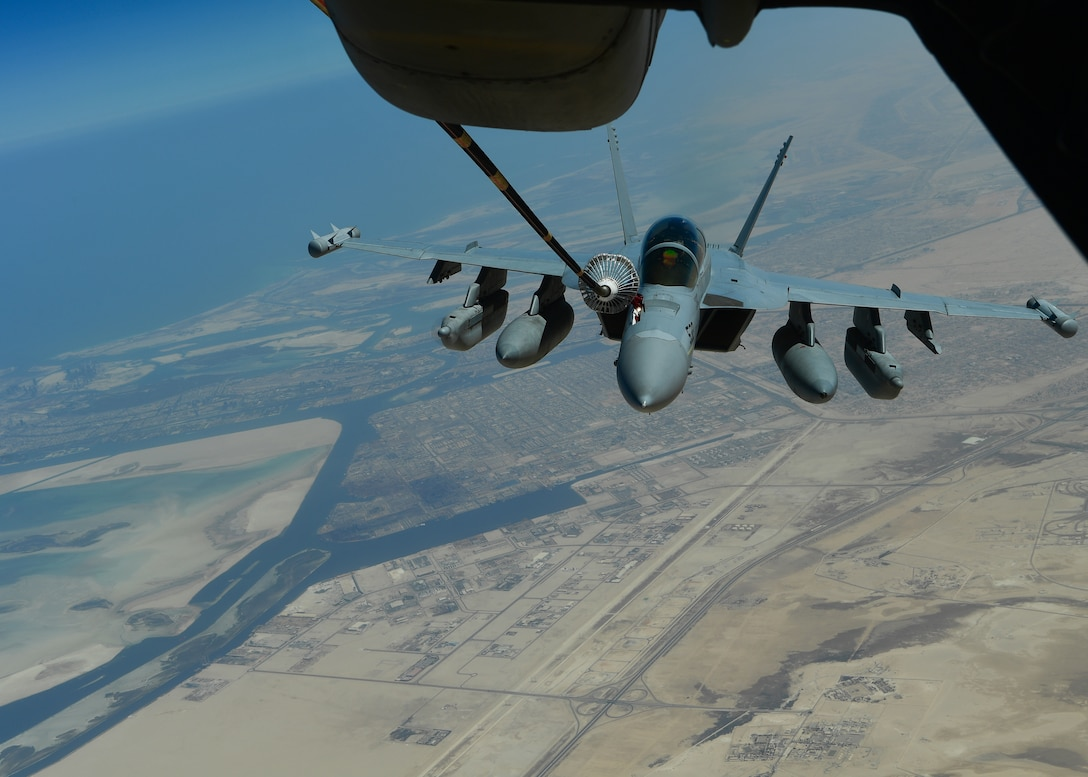 A U.S. Navy EA-18G Growler receives fuel from a KC-10 Extender assigned to the 908th Expeditionary Air Refueling Squadron out of Al Dhafra Air Base, United Arab Emirates, Aug. 28, 2019. The 908th EARS, part of U.S. Air Forces Central Command, is responsible for delivering fuel to U.S. and coalition forces, enabling a constant presence in the area of responsibility. (U.S. Air Force photo by Staff Sgt. Chris Drzazgowski)