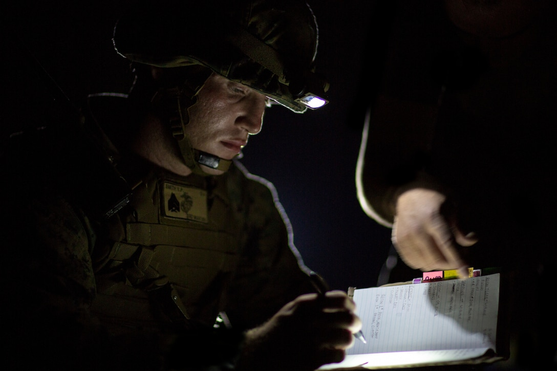 A U.S. Marine receives information on a simulated chemical hazard during Explosive Ordinance Disposal Exercise 19 on Camp Hansen, Okinawa, Japan, Sept. 17.