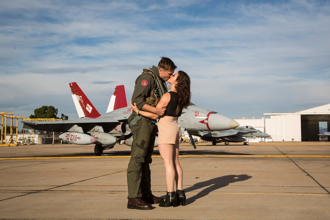 U.S. Marine Corps Capt. Robin Leilimarrazzo reunites with his wife during a homecoming ceremony at Marine Corps Air Station Miramar, Calif., September 15, 2019.
