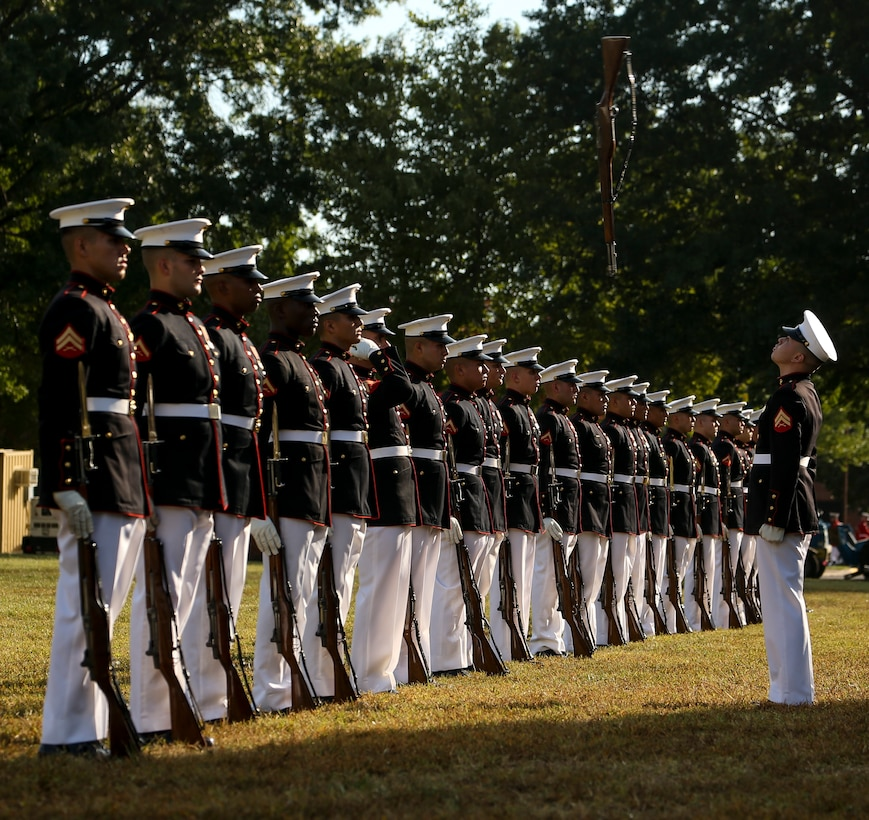 "U.S. Marines with the U.S. Marine Corps Silent Drill Platoon conduct their ""rifle inspection"" sequence during the 37th annual Enlisted Awards Parade at MCB Quantico, Virginia, Sept. 18."