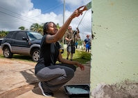 A woman aints a juvenile detention center in St. George's, Grenada.