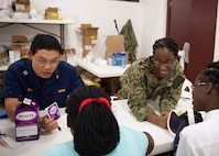 Pharmacists discuss medication with patients.