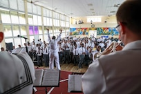 The U.S. Navy 4th fleet band delivers a performance to a Grenadian boys high school.