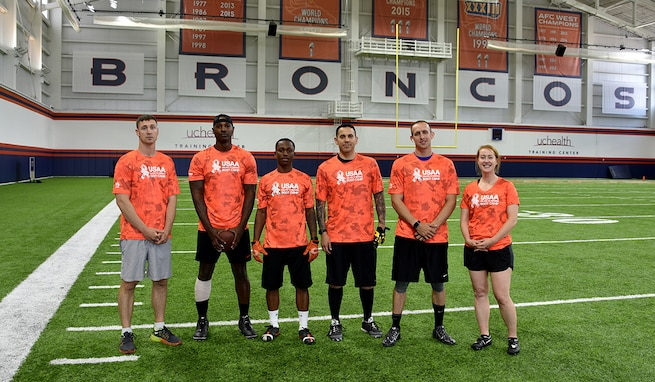 Team U.S. Army Space and Missile Defense Command (from left: Maj. Clifton Palmore, Staff Sgt. Brandon Vereen, Spc. Michael Isaac, Maj. Michael Smith, Capt. Bryce Thornton and Capt. Allison Foust) worked together to take first place in the 2019 Denver Broncos/USAA Salute to Service Boot Camp Competition Aug. 21 at the Denver Broncos' University of Colorado Health Training Center Fieldhouse in Englewood, Colorado. (U.S. Army photo by Dottie K. White)
