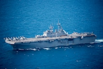 U.S. Navy amphibious assault ship USS Bataan (LHD 5) conducts a simulated strait transit during Amphibious Ready Group (ARG), Marine Expeditionary Unit (MEU) exercise (ARGMEUEX) in the vicinity of South Carolina, Aug. 30, 2019. Rehearsing strait transits help make the ARG/MEU team a more versatile, sea-based expeditionary force that can be tailored to a variety of missions. (U.S. Marine Corps photo by Cpl. Nathan Reyes)