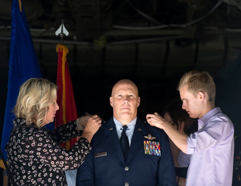U.S. Air Force Col. Daniel Gabrielli's wife and son pin on the rank of brigadier general in St. Paul, Minn., Sept. 14, 2019.