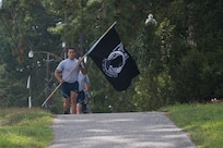 Airman 1st Class Kenneth Frechette, 628th Logistics Readiness Squadron supply technician, leads his group during a POW/MIA memorial run Sep. 20, 2019, at Joint Base Charleston, S.C.