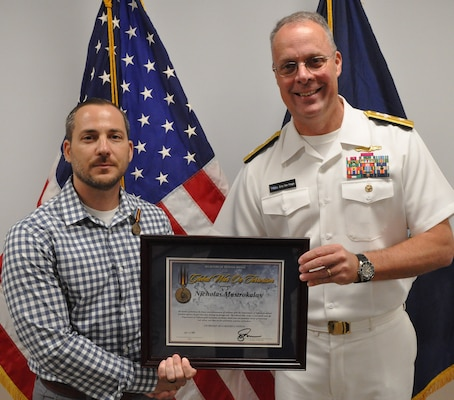 IMAGE: DAHLGREN, Va. (Aug. 30, 2019) – Naval Sea Systems Warfare Centers Commander Rear Adm. Eric Ver Hage presents the Secretary of Defense Medal for the Global War on Terrorism (GWOT) plaque to Nicholas Mastrokalos at an award ceremony moments after pinning the medal on Mastrokalos – a Naval Surface Warfare Center Dahlgren Division (NSWCDD) engineer. The GWOT Medal recognized and honored Mastrokalos' contributions and accomplishments in direct support of the armed forces engaged in operations to combat terrorism.