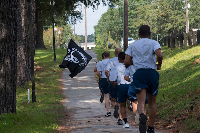 Airmen from the 628th Logistics Readiness Squadron run during a POW/MIA memorial run Sep. 20, 2019, at Joint Base Charleston, S.C.