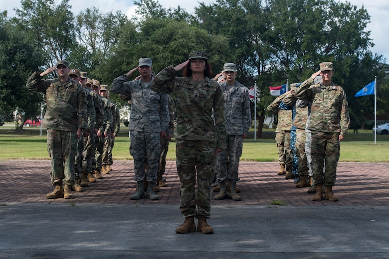 Lt. Col. Christine Smetana, 628th Operational Medical Readiness Squadron commander, leads a flight in rendering a salute during a retreat ceremony Sep. 20, 2019, at Joint Base Charleston, S.C.