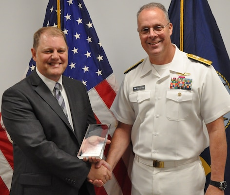 IMAGE: DAHLGREN, Va. (Aug. 30, 2019) – Naval Sea Systems Warfare Centers Commander Rear Adm. Eric Ver Hage presents the Dr. Delores M. Etter Award to Dennis Larsen, Naval Surface Warfare Center Dahlgren Division (NSWCDD) engineer, at an awards ceremony held at NSWCDD headquarters. The Etter Award is presented annually to scientists and engineers who have clearly demonstrated a superior accomplishment that is technically outstanding and highly beneficial operationally to the Department of the Navy, Department of Defense, and national defense.  (Photo by U.S. Navy/Released)