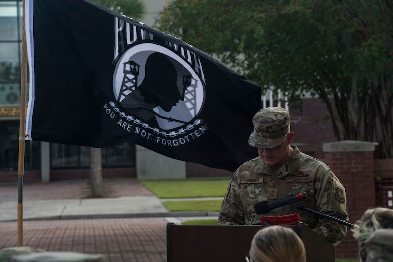 Chief Master Sgt. Ronnie Phillips, 437th Airlift Wing command chief, gives a speech prior to a retreat ceremony about a family relative who was a prisoner of war Sep. 20, 2019, at Joint Base Charleston, S.C.