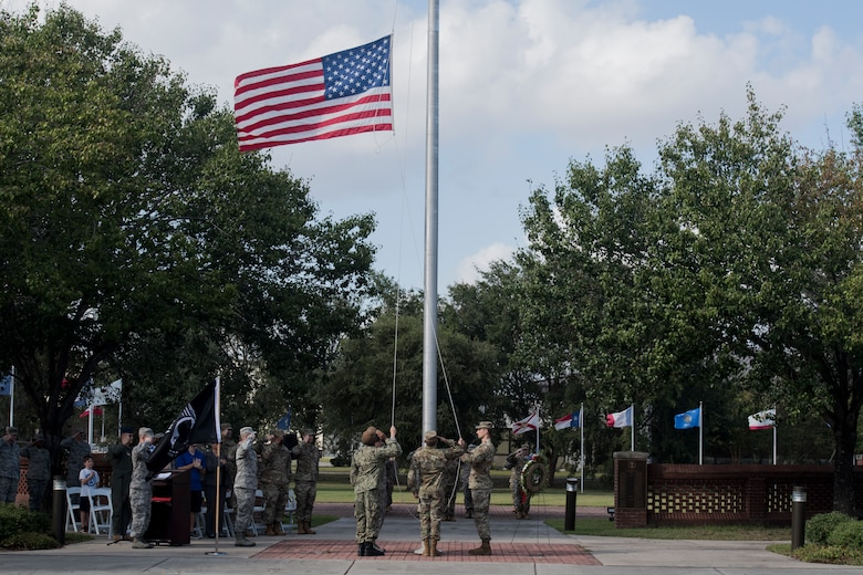 Airmen from Joint Base Charleston lower the U.S. Flag during a retreat ceremony Sep. 20, 2019, at Joint Base Charleston, S.C.