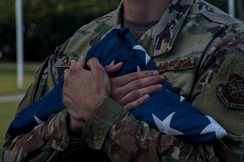 Senior Airman Jack Safford, 628th Logistics Readiness Squadron vehicle maintenance technician, holds a folded flag after a retreat ceremony Sep. 20, 2019, at Joint Base Charleston, S.C.