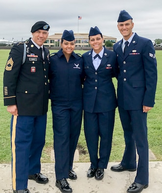 U.S. Army Sgt. Maj. Ernesto Lopez Jr., left, Air Force Airman Basic Jennifer Lopez-Falcon, Airman 1st Class Joanna Lopez, and Senior Airman Ernesto Lopez-Falcon pose for a family photo after Airman Jennifer Lopez-Falcon's basic military training graduation at Lackland Air Force Base, Texas, May 10, 2019.