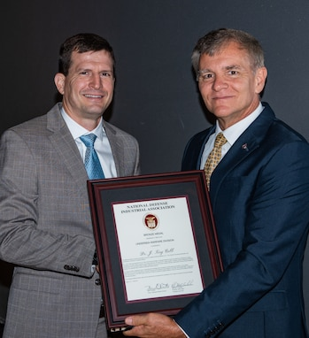 "Dr. James ""Tory"" Cobb, distinguished scientist for advance signal processing and automation in mine warfare at Naval Surface Warfare Center Panama City Division, left, is presented with the National Defense Industrial Association (NDIA) Award for Technical Achievement in Undersea Warfare by Mike Cortese,division chair for the Undersea Warfare Division Sept. 17 in Groton, Connecticut."