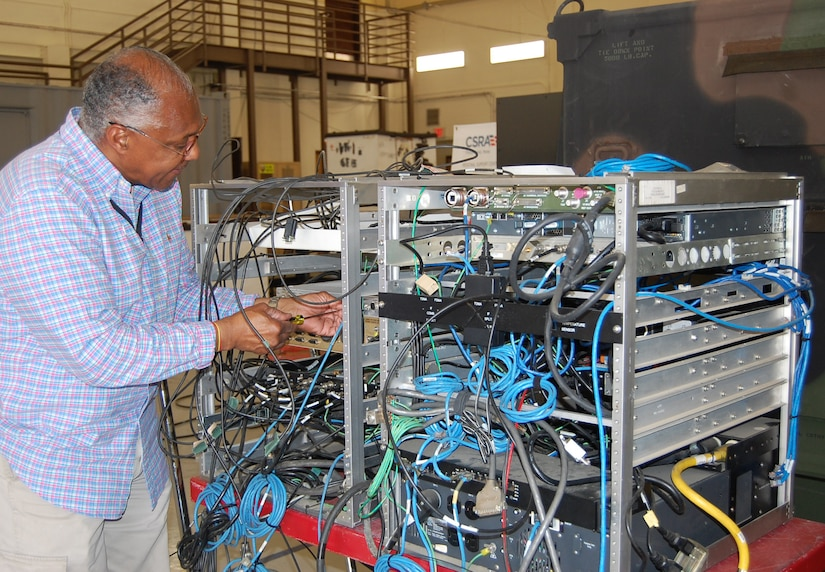 Photo of employee working at our forward repair facility.