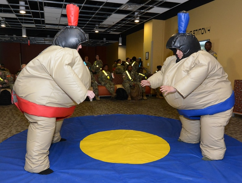Two Soldiers have fun in Sumo wrestler costumes.