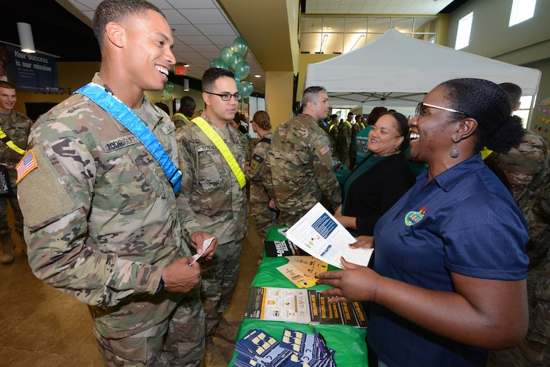Volunteers from the Army Substance Abuse Program, or ASAP, hand out literature to Soldiers.