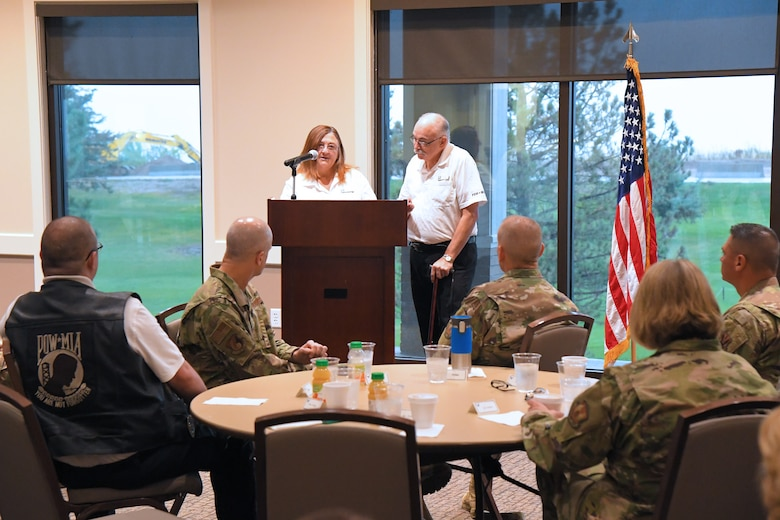 Penny and Kurt Falkner of the POW/MIA Awareness Organization of Utah speak at the POW/MIA Remembrance breakfast Sept. 20 at Hubbard Golf Course.  The event gave Team Hill members a chance to honor prisoners of war and those still missing in action.