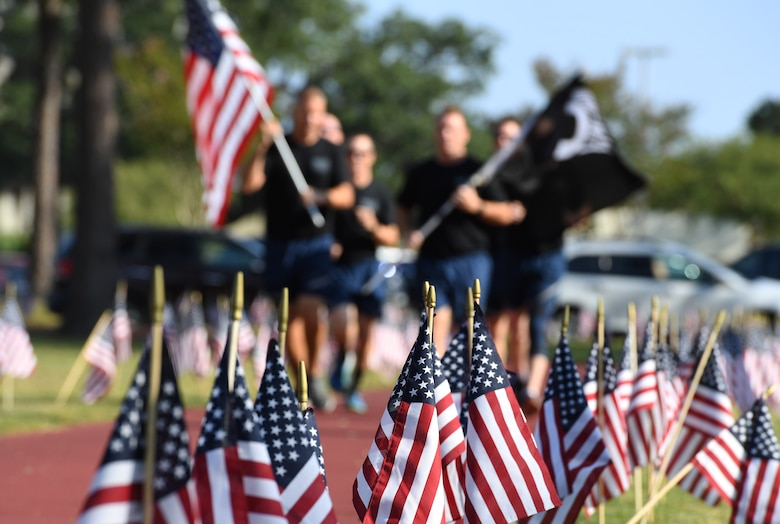 Flags line the track during Keesler's POW/MIA 24-hour memorial run and vigil at the Crotwell Track on Keesler Air Force Base, Mississippi, Sept. 18, 2019. This event is held annually to raise awareness and pay tribute to all prisoners of war and the military members still missing in action. (U.S. Air Force photo by Kemberly Groue)