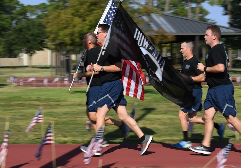 Members of Second Air Force participate in Keesler's POW/MIA 24-hour memorial run and vigil at the Crotwell Track on Keesler Air Force Base, Mississippi, Sept. 18, 2019. This event is held annually to raise awareness and pay tribute to all prisoners of war and the military members still missing in action. (U.S. Air Force photo by Kemberly Groue)