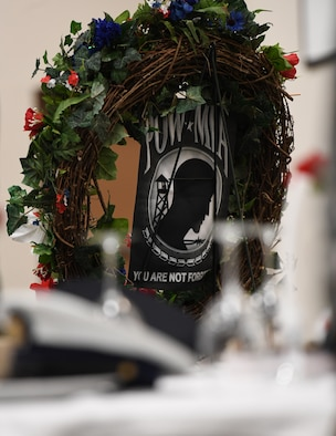 A wreath is on display during the POW/MIA remembrance luncheon inside the Roberts Consolidated Aircraft Maintenance Facility at Keesler Air Force Base, Mississippi, Sept. 20, 2019. The event, hosted by the Air Force Sergeants Association, was held to raise awareness and to pay tribute to all prisoners of war and those military members still missing in action. (U.S. Air Force photo by Kemberly Groue)