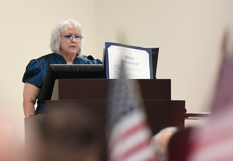 Diane Moore, daughter of U.S. Air Force Chief Master Sgt. Thomas Moore, POW/MIA Vietnam, delivers remarks during the POW/MIA remembrance luncheon inside the Roberts Consolidated Aircraft Maintenance Facility at Keesler Air Force Base, Mississippi, Sept. 20, 2019. The event, hosted by the Air Force Sergeants Association, was held to raise awareness and to pay tribute to all prisoners of war and those military members still missing in action. (U.S. Air Force photo by Kemberly Groue)