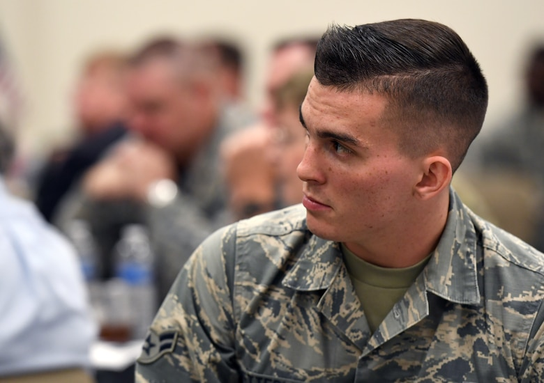 U.S. Air Force Airman 1st Class Matthew Ketterling, 81st Aerospace Medicine Squadron bioenvironmental engineering technician, attends the POW/MIA remembrance luncheon inside the Roberts Consolidated Aircraft Maintenance Facility at Keesler Air Force Base, Mississippi, Sept. 20, 2019. The event, hosted by the Air Force Sergeants Association, was held to raise awareness and to pay tribute to all prisoners of war and those military members still missing in action. (U.S. Air Force photo by Kemberly Groue)
