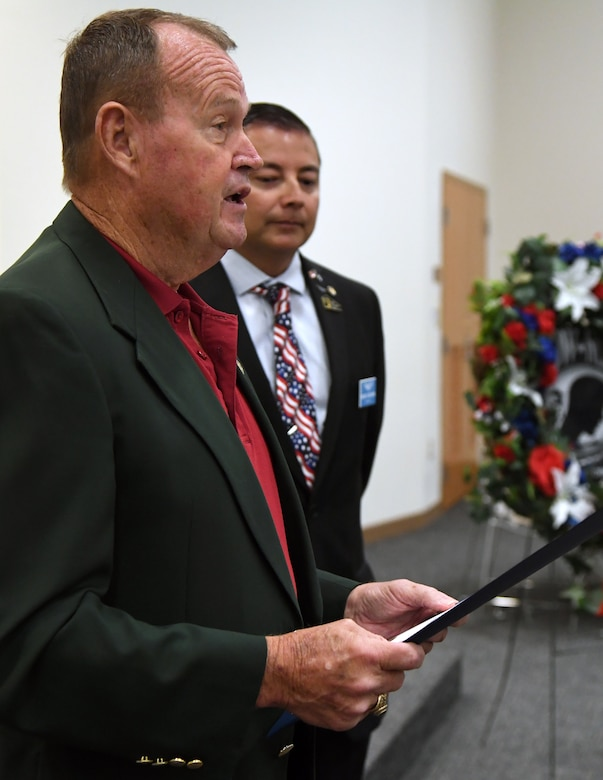 "Mike Leonard, Biloxi city administrator, reads a ""Prisoner Of War and Missing In Action Remembrance Day in the City of Biloxi"" proclamation during the POW/MIA remembrance luncheon inside the Roberts Consolidated Aircraft Maintenance Facility at Keesler Air Force Base, Mississippi, Sept. 20, 2019. The event, hosted by the Air Force Sergeants Association, was held to raise awareness and to pay tribute to all prisoners of war and those military members still missing in action. (U.S. Air Force photo by Kemberly Groue)"
