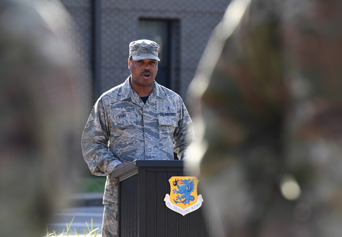 U.S. Air Force Chief Master Sgt. Kevin Osby, 81st Diagnostic and Therapeutics Squadron superintendent, delivers remarks during the POW/MIA retreat ceremony at Keesler Air Force Base, Mississippi, Sept. 20, 2019. The event was held to raise awareness and to pay tribute to all prisoners of war and those military members still missing in action. (U.S. Air Force photo by Kemberly Groue)