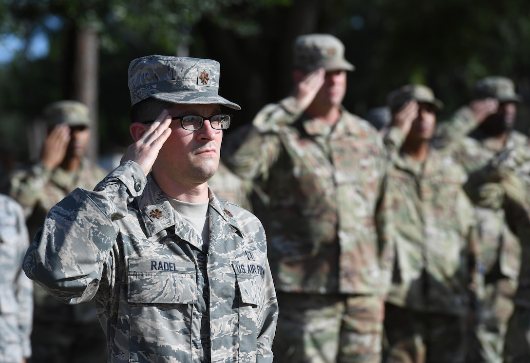 U.S. Air Force Maj. Joshua Radel, 81st Diagnostic and Therapeutics Squadron clinic pharmacist, renders a salute during the POW/MIA retreat ceremony at Keesler Air Force Base, Mississippi, Sept. 20, 2019. The event was held to raise awareness and to pay tribute to all prisoners of war and those military members still missing in action. (U.S. Air Force photo by Kemberly Groue)