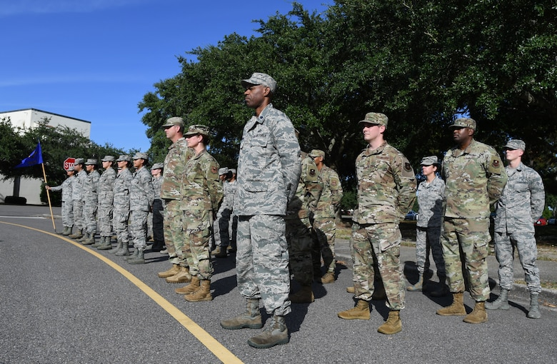Keesler Airmen stand in formation during the POW/MIA retreat ceremony at Keesler Air Force Base, Mississippi, Sept. 20, 2019. The event was held to raise awareness and to pay tribute to all prisoners of war and those military members still missing in action. (U.S. Air Force photo by Kemberly Groue)