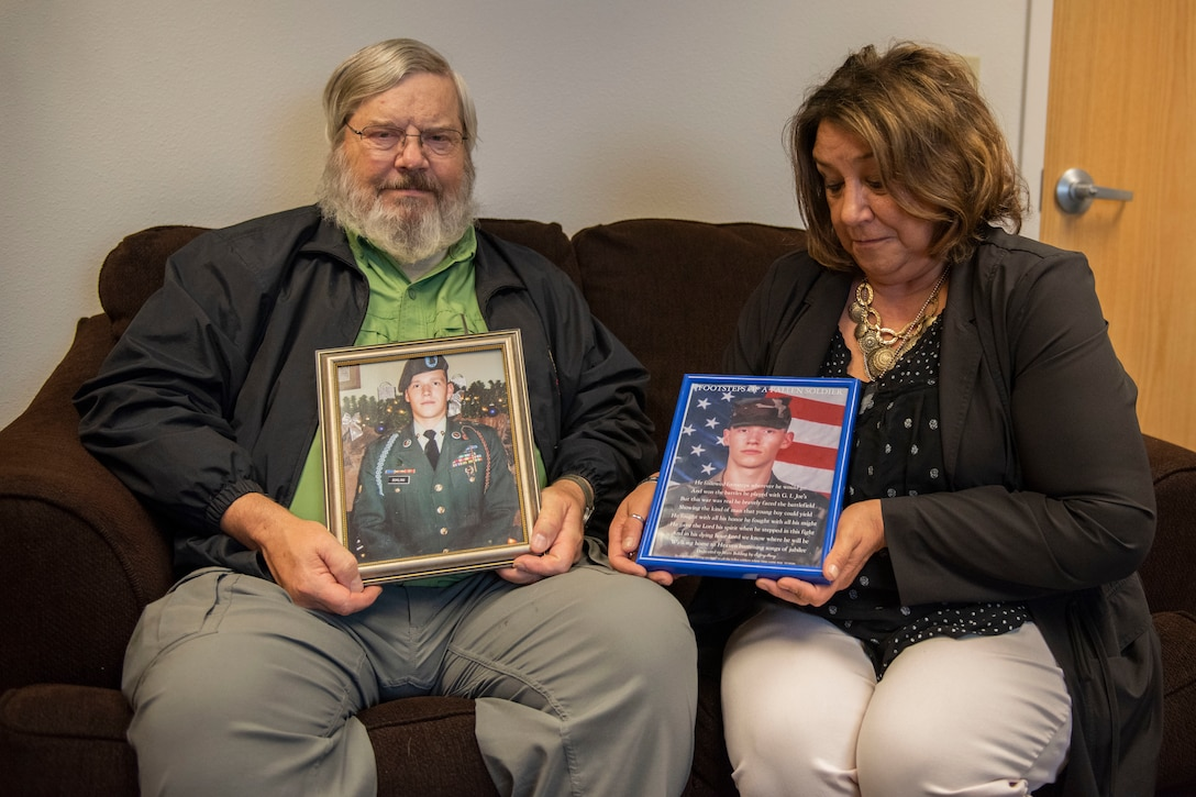 Sandy Bohling, a learning and development training specialist with Southcentral Foundation, and Charles Bohling, a retired U.S. Army National Guard master sergeant, hold photos of their son, Matthew, Sept. 19, 2019 on Joint Base Elmendorf-Richardson, Alaska. Matthew H. Bohling, assigned to the 2nd Battalion, 69th Armor Regiment, 3rd Brigade, 3rd Infantry Division at Fort Benning, Georgia, died in Ramadi, Iraq, Sept. 5, 2005, when an improvised explosive device detonated near his Humvee during combat operations. The last Sunday of September is National Gold Star Mother's and Family's Day, a tribute to recognize and honor the immeasurable loss suffered by the surviving parents and families of those killed in action.