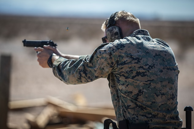 U.S. Marines with the Provost Marshals Office (PMO), Headquarters and Headquarters Squadron, Marine Corps Air Station (MCAS) Yuma, engage targets during a law enforcement (LE) range qualification on MCAS Yuma, Sep. 18th 2019. The LE qualification is specific to military police personnel, including several different shooting methods with both the Beretta M9 and Benelli 12 gauge shotgun. (U.S. Marine Corps photo by Lance Cpl John Hall)