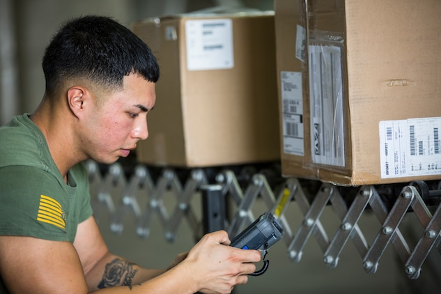 U.S. Marine Corps Cpl. Justus Abarquez, a distribution management Marine assigned to Headquarters and Headquarters Squadron (H&HS), helps Marines assigned to Marine Aviation Logistic Squadron 13 (MALS-13) take inventory of their newly signed-for gear on Marine Corps Air Station (MCAS) Yuma, Ariz., Sept. 9, 2019. As a distribution management Marine, Cpl. Abarquez plays an important part in allowing the Distribution Management Office (DMO) to support all of the units aboard MCAS Yuma by recieving, shipping, and distributing all packages to their respective units on the air station. (U.S. Marine Corps photo by Sgt. Isaac D. Martinez)